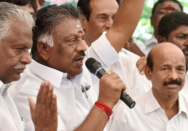 Panneerselvam addressing at a press conference at his