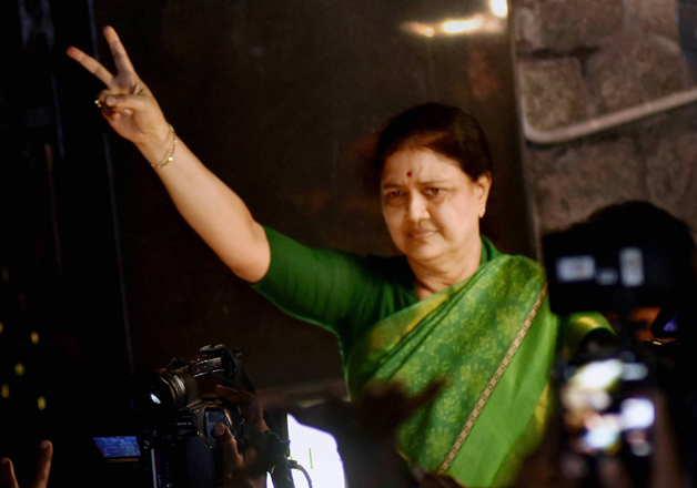 File pic - Sasikala flashes victory sign at Poes garden in