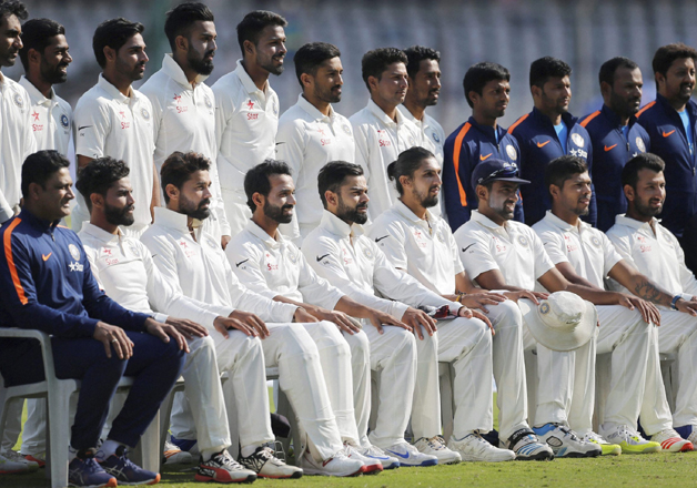 File pic - Team India with supporting staff pose for a