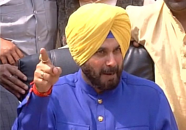 Congress leader Navjot Singh Sidhu speaks to media in