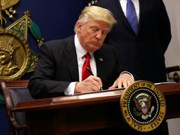 Donald Trump signs order to roll back Obama's climate
