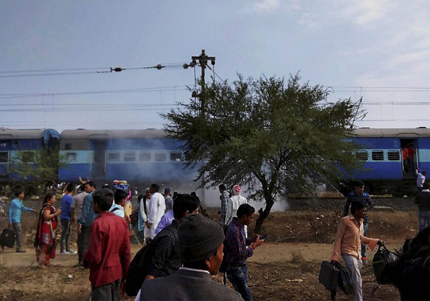 Smoke erupts from a bogie after a blast in the