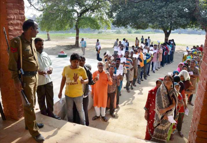 People at a polling booth to cast their vote in UP