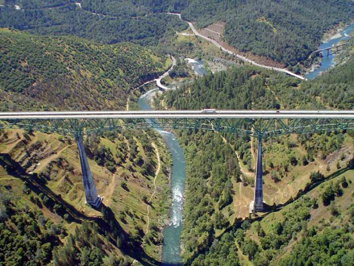 Woman falls off tallest California bridge while taking