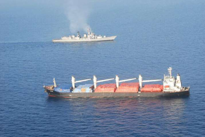 INS Mumbai with the MV OS 35 that was attacked by pirates
