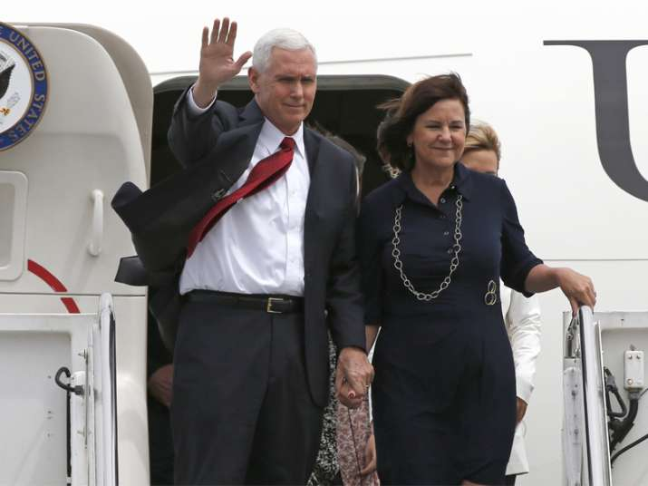 Mike Pence with his wife Karen arrive at US Navy's Atsugi