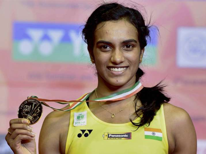 Sindhu poses with her medal after winning final of the