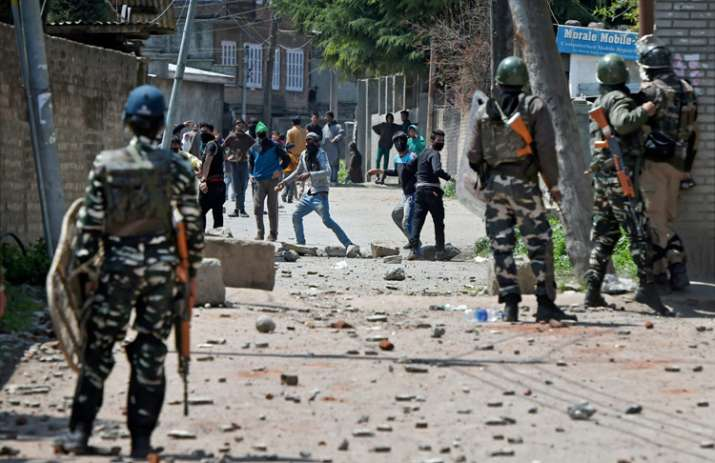 Youths throw stones on Security forces during clashes in