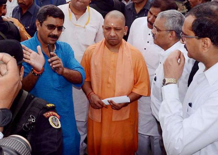 Adityanath being briefed about the bridge made on the