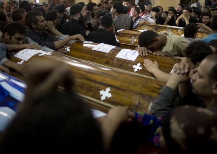 Relatives of Coptic Christians who were killed during a bus