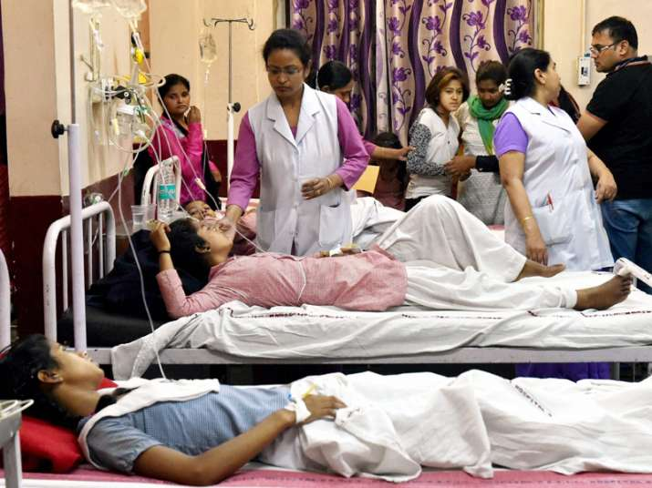 School students being treated at a hospital in New Delhi on