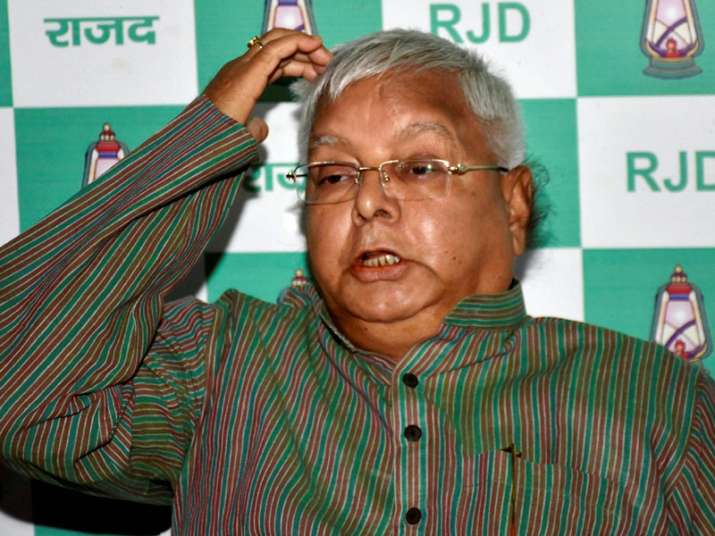 Lalu addressing a press conference at his residence in