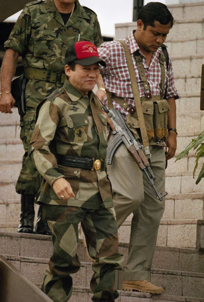 India Tv - Oct 4, 1989 file photo Noriega leaves defense forces headquarters in Panama City