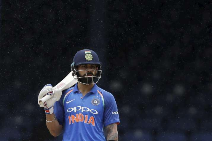 Virat Kohli reacts after rain stopped play at the Queen's