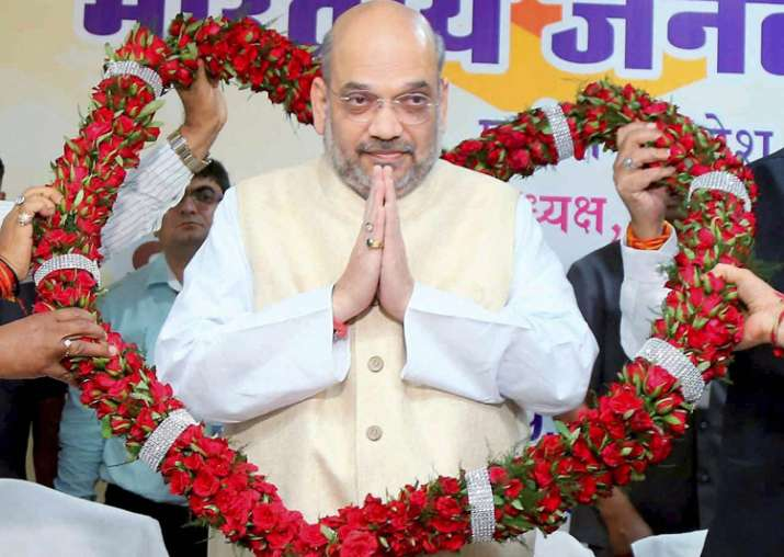 Amit Shah being garlanded during a meeting with party MPs,