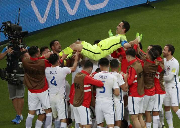 Chile players celebrate their win against Portugal in