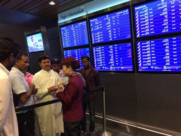Passengers of cancelled flights wait at Dohar Airport