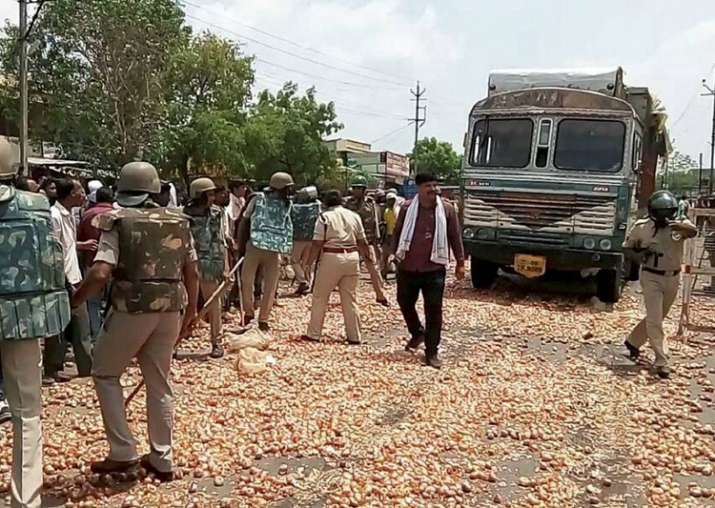 File pic - Farmers throwing vegetables on the road during