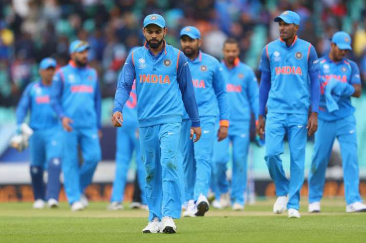 Virat Kohli of India leads the team off the field after
