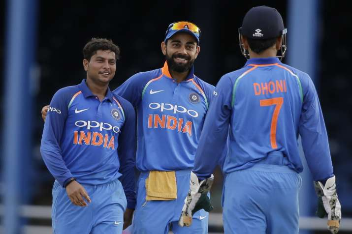 Kuldeep Yadav celebrates fall of wicket with skipper Virat