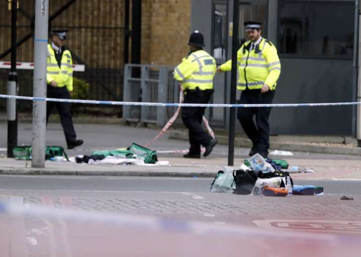 Police patrol nears bags of evidence collected in London