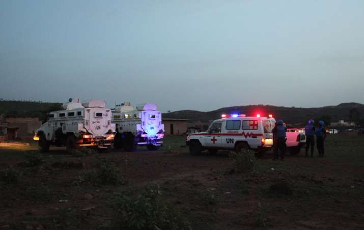 UN armored personnel vehicles stationed with an ambulance