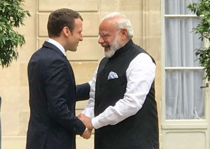 PM Modi meets French President Emmanuel Macron in Paris