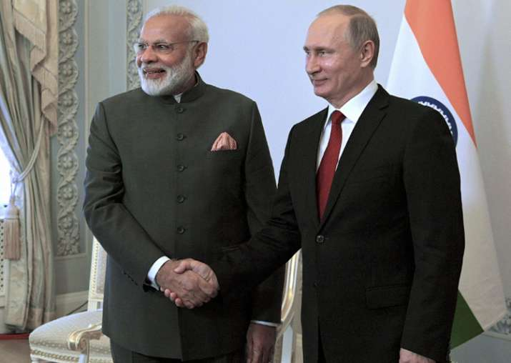 Putin shakes hands with Modi at the St. Petersburg
