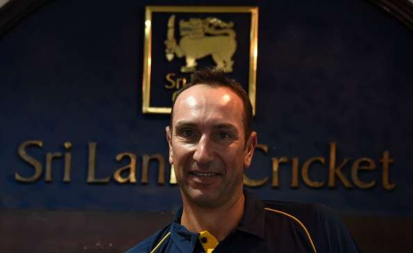 Former South African cricketer Nic Pothas looks on during a