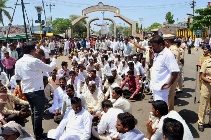 Farmers block the road during a protest in Solapur,