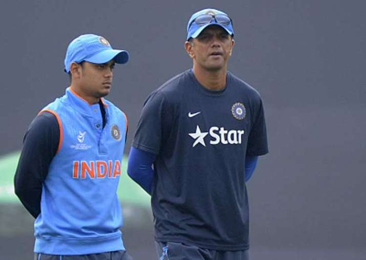 Ishan Kishan of India walks with coach Rahul Dravid of India