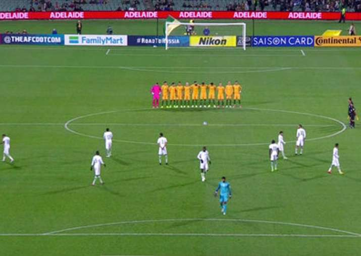 Saudi Arabian players walk on the field during a minute of