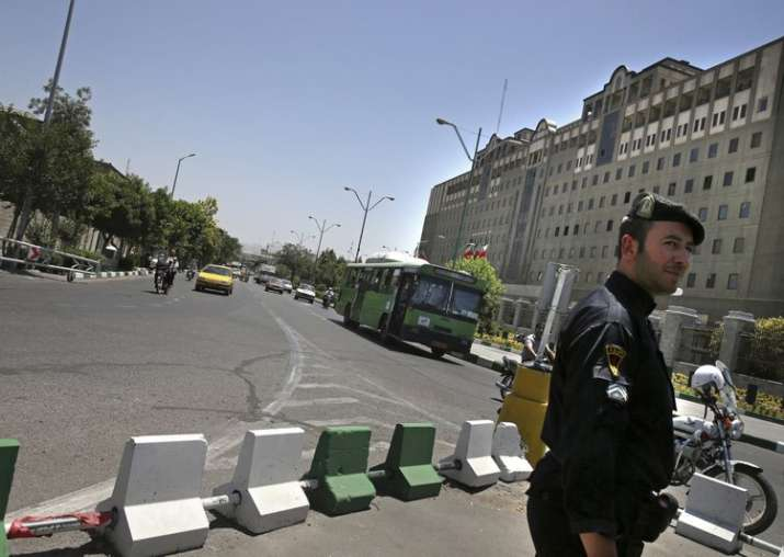 A police officer stands guard in front of Iran's