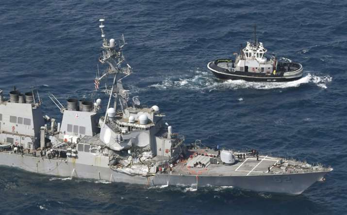 US Navy ship damaged in collision with container ship off