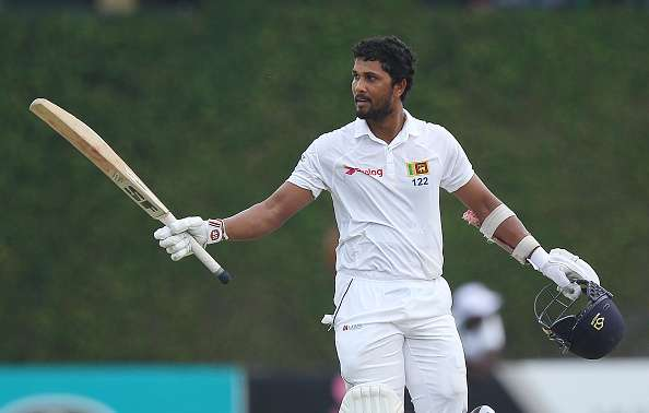 Dinesh Chandimal raises his bat to acknowledge the crowd