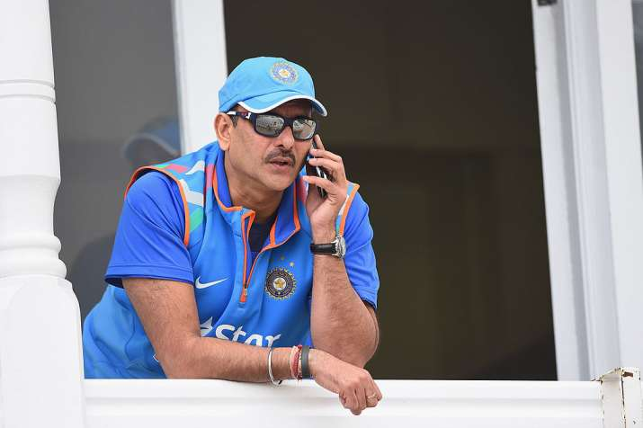 Ravi Shastri of India speaks on the phone during net