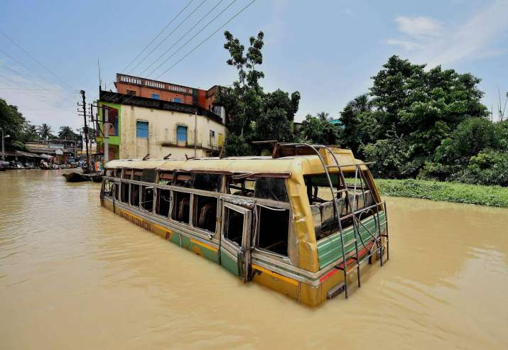 A bus submerged in flood waters at Ghatal in West