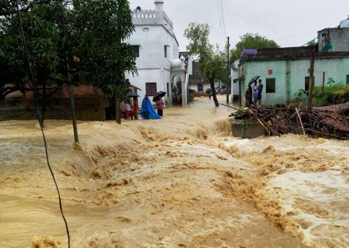 India Tv - A view of a flooded village in West Champaran district of Bihar