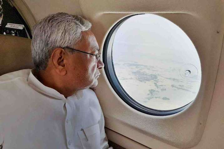 India Tv - Nitish Kumar conducts an aerial survey of flood hit regions of Bihar on Monday