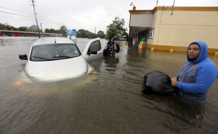 A stuck car in rising floodwaters from Tropical Storm