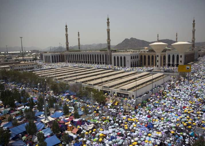 Muslim pilgrims attend noon prayers outside the Namirah