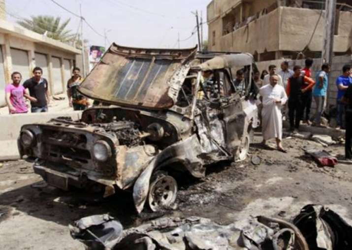 Image result for Scores killed in twin southern Iraq attacks claimed by IS group