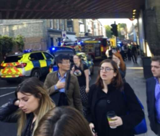 India Tv - People leave the scene of an explosion at a southwest London subway station.
