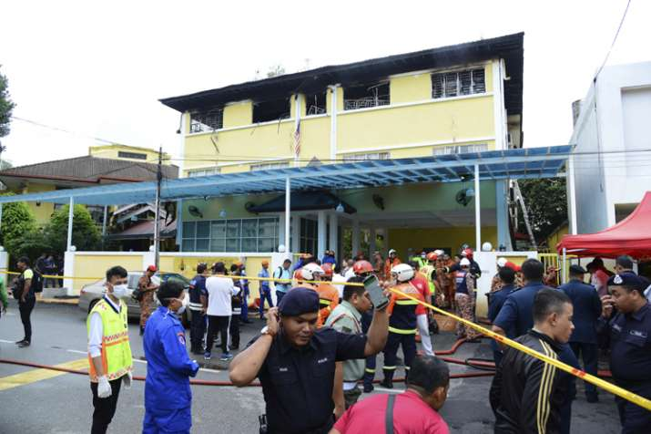 Community's grief after fire kills at least 23 at Malaysia boarding school