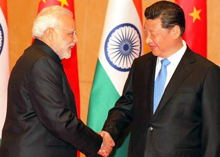 Chinese President Xi Jinping greets Prime Minister Narendra