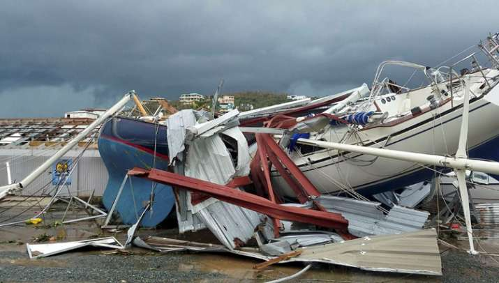 India Tv - Neighbors clear debris from the road in St. Thomas, U.S. Virgin Islands