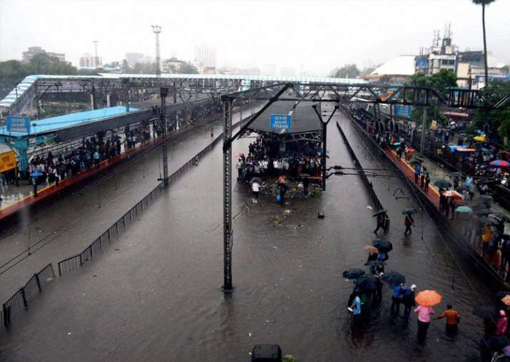 India Tv - A view of flooded Thane Railway station