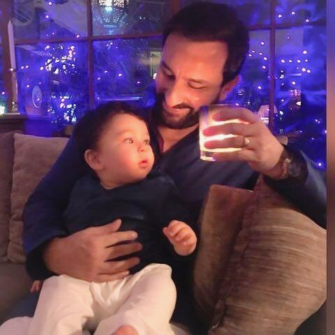 India Tv - taimur with dad saif