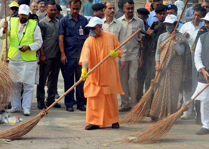 India Tv - Adityanath weilds a broom as he takes part in a cleanliness drive at the western gate of the Taj Mahal in Agra
