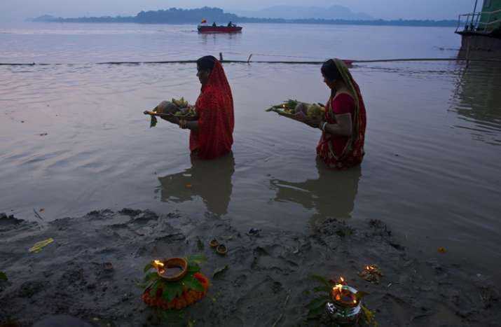 India Tv - Devotees perform rituals in the the Brahmaputra river during the Chhath Puja festival in Gauhati, Assam